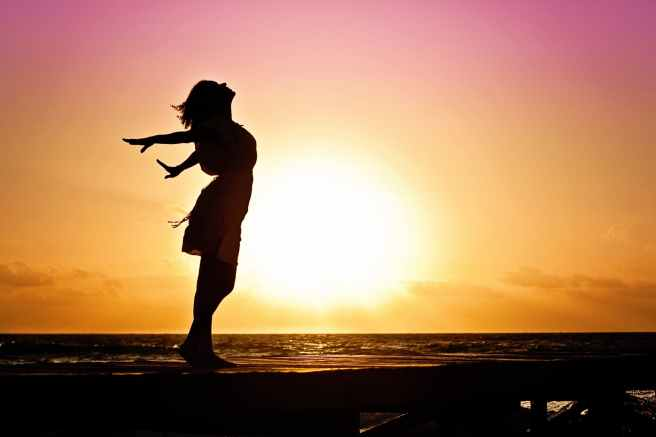 woman-happiness-sunrise-silhouette-40192.jpeg
